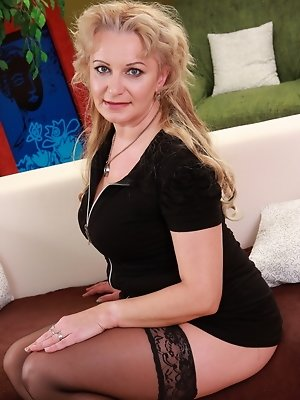Naughty blonde mature lady playing with herself