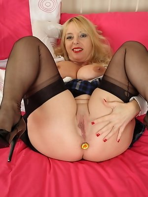 Big breasted British mom playing with herself
