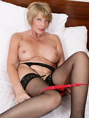 Steamy British housewife playing with her toy in bed