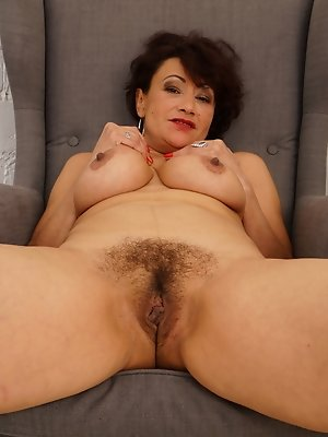 Hairy housewife masturbating on the couch
